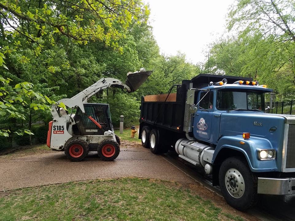 Rob's Trucking on a concrete tear out with a Bobcat and vintage Mack Superliner, Old Blue
