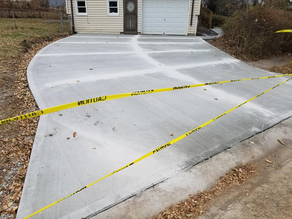 Rob's Trucking concrete artisans easily transform your landscape with stamped patios, pool decks, poured concrete retaining walls